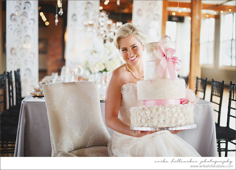 Bride at La Piece holding wedding cake by Ooo La La Cakes