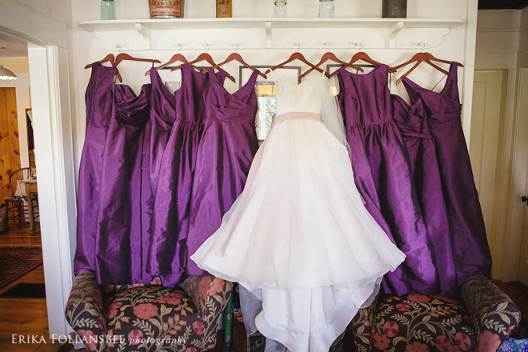 wedding gown and bridesmaids dresses hanging up
