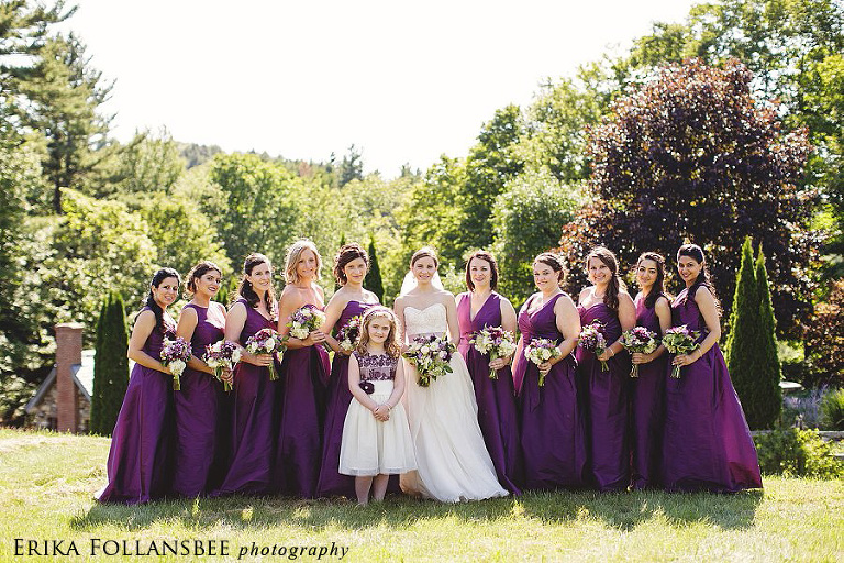 large bridal party in purple dresses