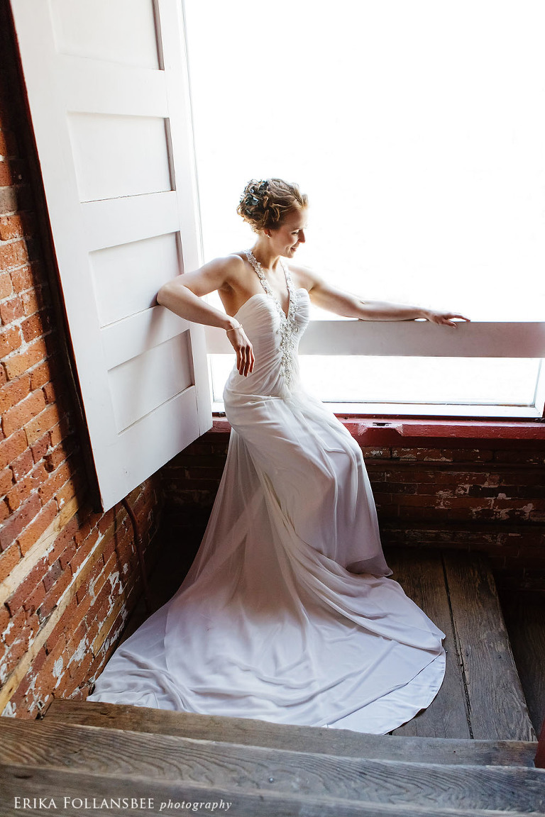 belknap mill wedding photo bride in window