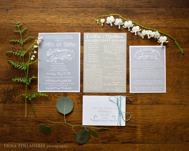 gray invitation suite with wood background