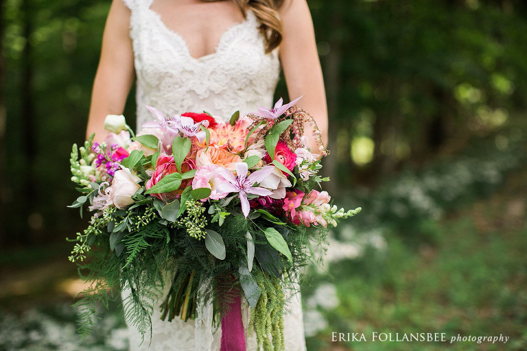 bride holding a large, colorful, free-form bouquet by Sorella Flower Company