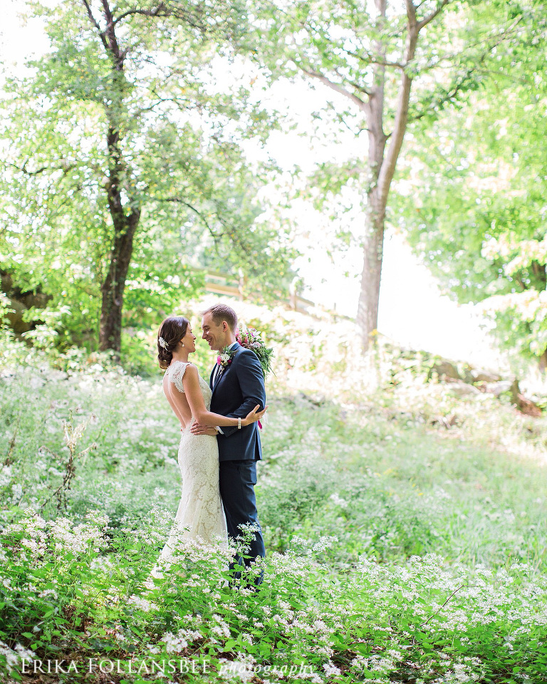 wedding portrait in the woods surrounded by little white flowers | NH Wedding Photographer