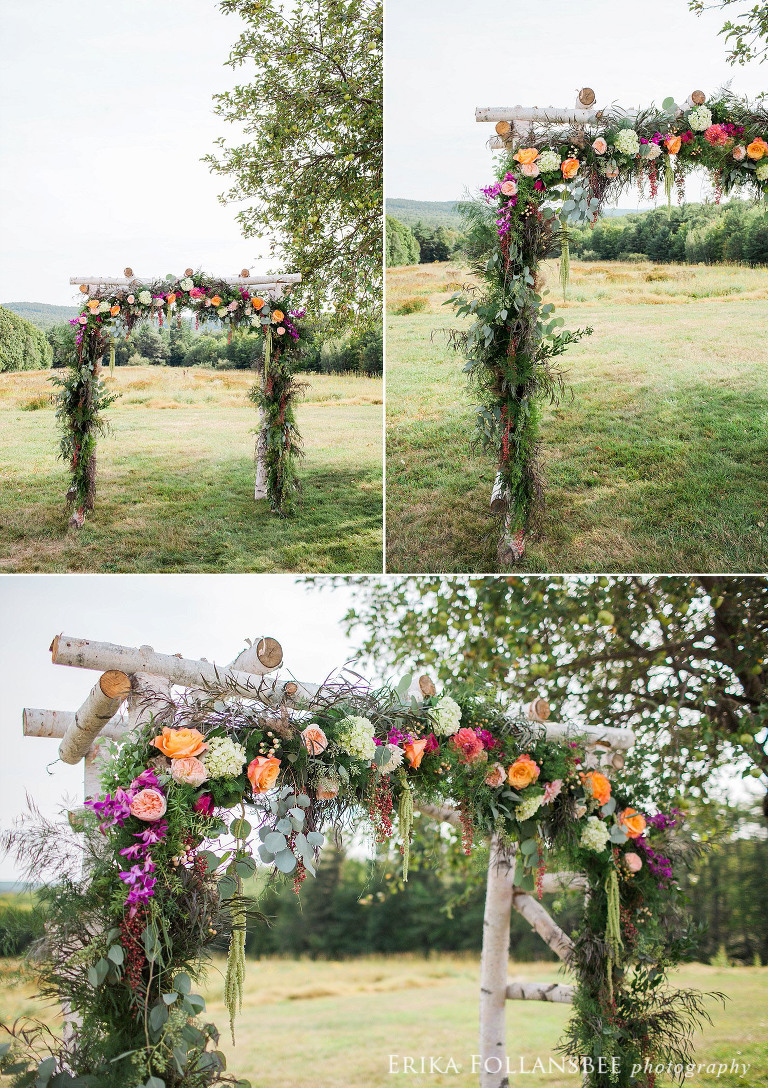 Wedding arbor decorated with flowers and greenery by Sorella Flower Company