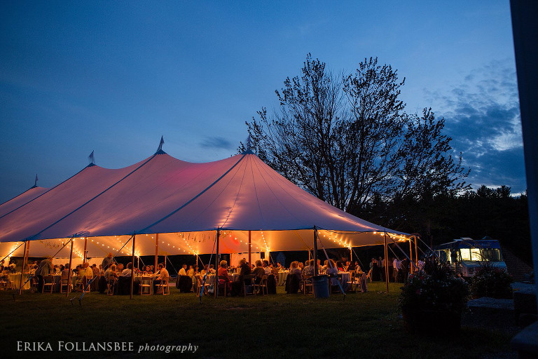 The sailcloth tent glows festively against the evening sky