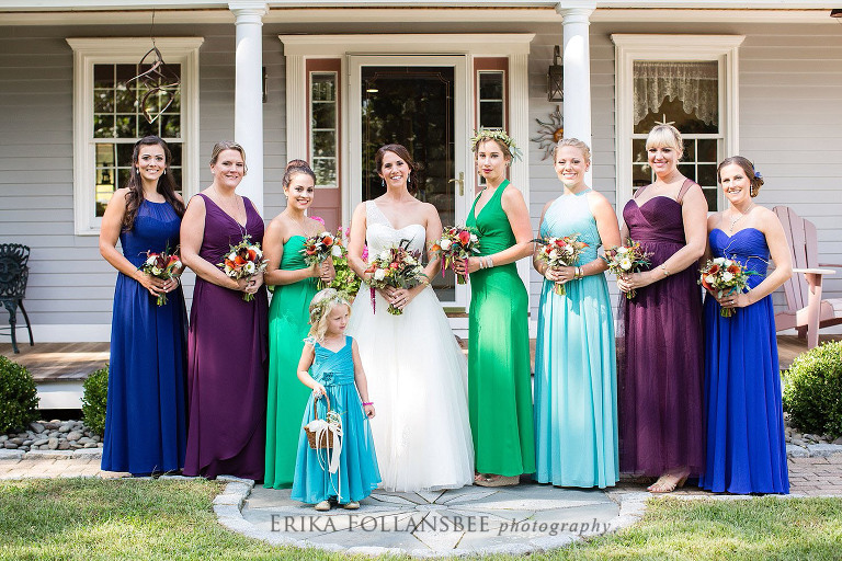 bridesmaids in peacock colored dresses