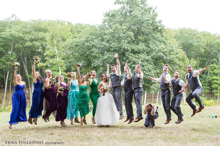 bridal party jumping into the air