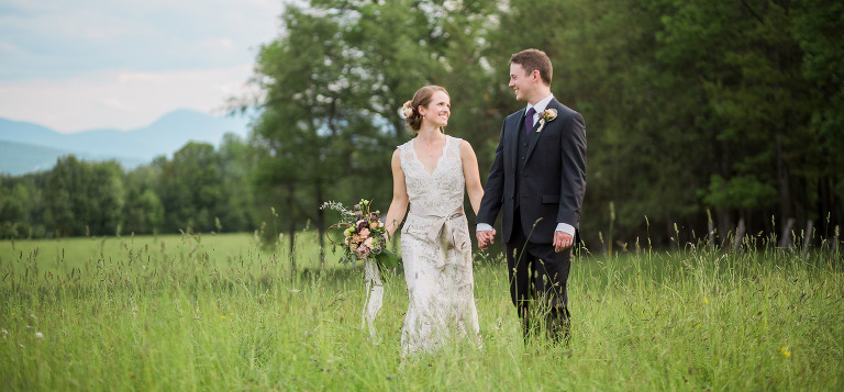 Bride and Groom in a field in the White Mountains of NH | Jefferson NH Wedding Photographer